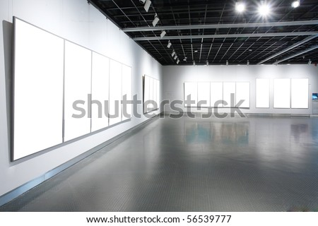empty frames in a room against a white wall #56539777