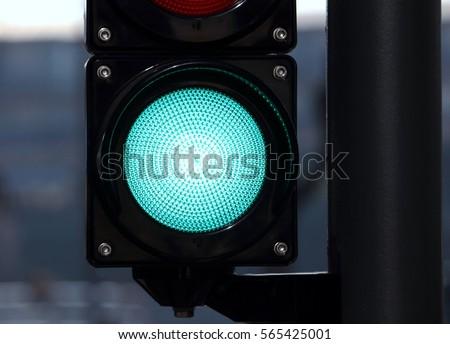 Green color on the traffic light, green circle black square shape traffic light, modern road sign urban design #565425001