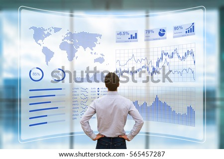 Person using a futuristic HUD interface screen with data and key performance indicators (KPI) for business intelligence (BI) analytics, concept, financial dashboard, technology, virtual reality (VR) Royalty-Free Stock Photo #565457287