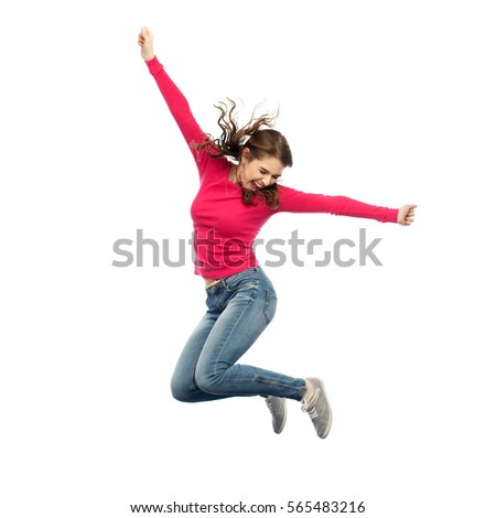 happiness, freedom, motion and people concept - smiling young woman jumping in air over white background Royalty-Free Stock Photo #565483216