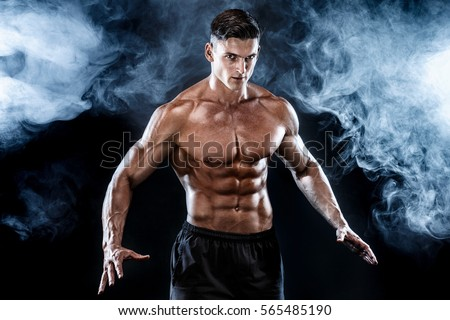 Strong bodybuilder man with perfect abs, shoulders,biceps, triceps, chest. #565485190