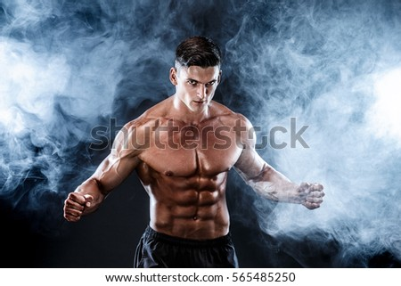 Strong bodybuilder man with perfect abs, shoulders,biceps, triceps, chest. #565485250
