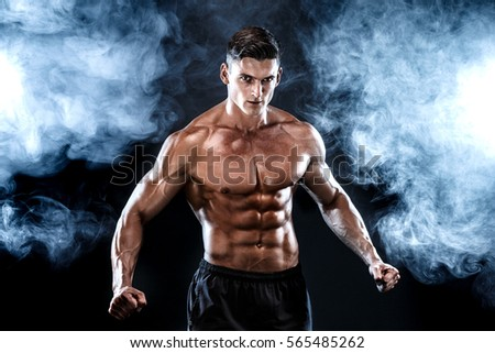 Strong bodybuilder man with perfect abs, shoulders,biceps, triceps, chest. #565485262