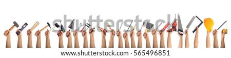 Hands holding construction tools isolated on white background. Banner, collage Royalty-Free Stock Photo #565496851