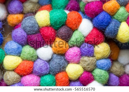 colorful balls of wool tied together for background #565516570