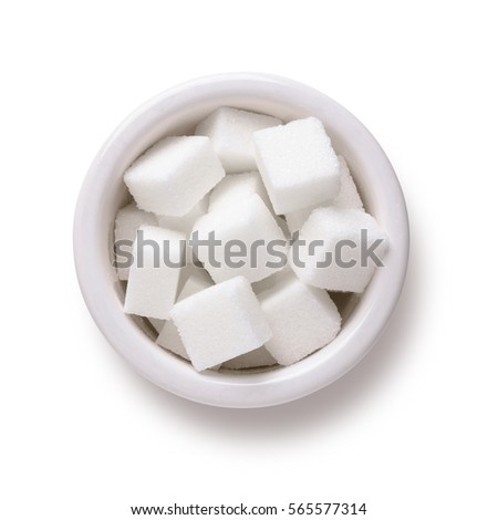 Sugar cubes in white bowl shot directly above isolated on white background with clipping path #565577314