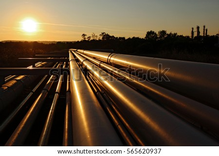 steel pipeline system during sunset #565620937