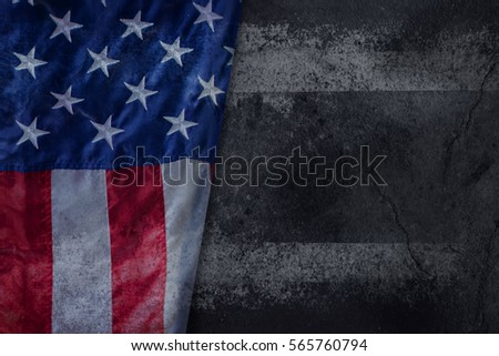 USA or American flag freely lying on Grunge concrete background, Close-up shot #565760794