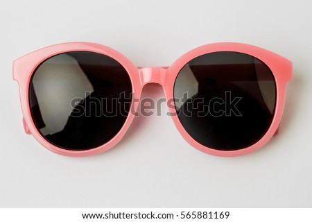 Cool sunglasses isolated on white background, top view. Royalty-Free Stock Photo #565881169