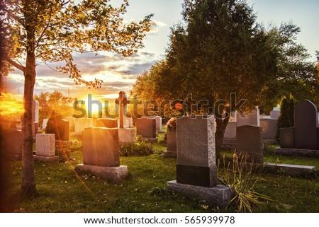 cemetery sunrise Royalty-Free Stock Photo #565939978