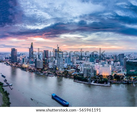 Top view aerial photo from flying drone of a Ho Chi Minh City with development buildings, transportation, energy power infrastructure. Financial and business centers in developed Vietnam