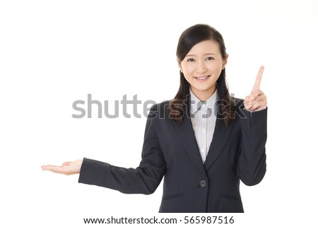 Business woman pointing with her finger  #565987516