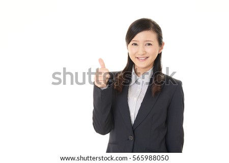 Business woman showing thumbs up sign #565988050