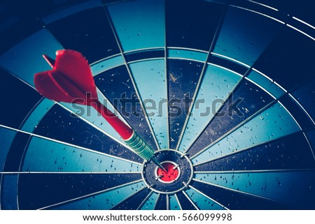 Bullseye is a target of business. Dart is an opportunity and Dartboard is the target and goal. So both of that represent a challenge in business marketing as concept. #566099998