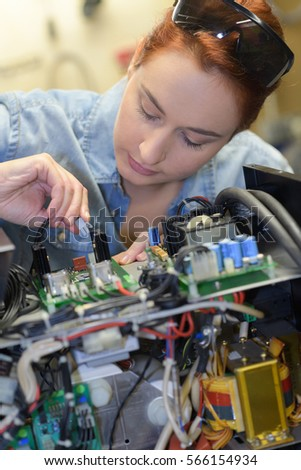 woman fixing a computer at work #566154934