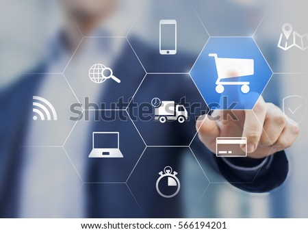 Businessman touching e-commerce button on a virtual interface with icons of shopping cart, delivery, credit card and wireless web, concept about online purchase on internet Royalty-Free Stock Photo #566194201