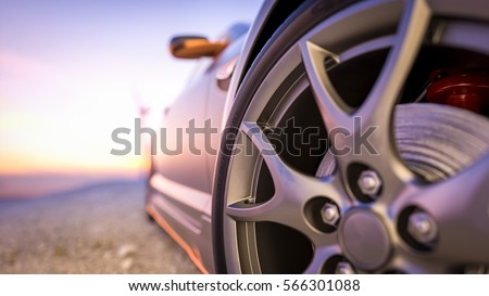 Close-up photos wheel sport. The scene behind as the sun going down with wind turbines in the back. #566301088