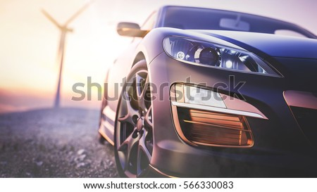 The image in front of the sports car scene behind as the sun going down with wind turbines in the back. Royalty-Free Stock Photo #566330083