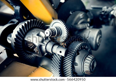 Cogwheels machinery , engineering and industry or concepts such as teamwork and search engine #566420950