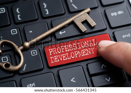 Closed up finger on keyboard with word PROFESSIONAL DEVELOPMENT #566431345
