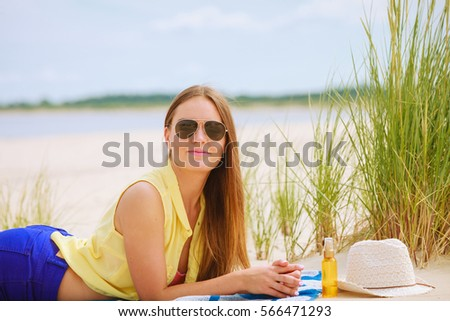 Relax and leisure. Young woman resting on summer beach. Pretty girl sunbathing on fresh air in summer. #566471293