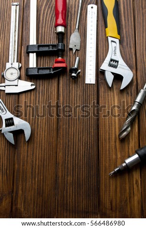 Metal Building tools on a wooden background #566486980