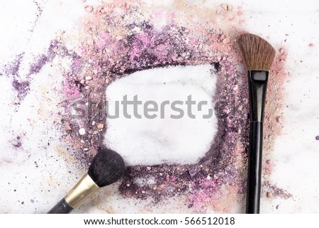 Makeup brushes on white marble background, with traces of powder and blush forming a frame. A horizontal template for a makeup artist's business card or flyer design, with copy space