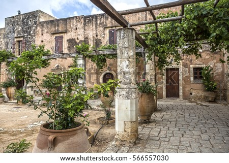 Inner yard of Arkadi Monastery, Crete, Greece #566557030