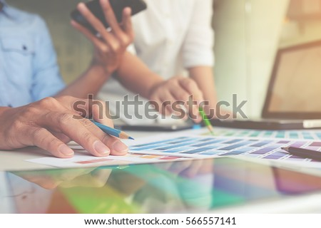 Graphic design and color swatches and pens on a desk. Architectural drawing with work tools and accessories.   #566557141