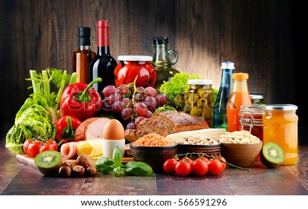Composition with variety of organic food products on kitchen table Royalty-Free Stock Photo #566591296