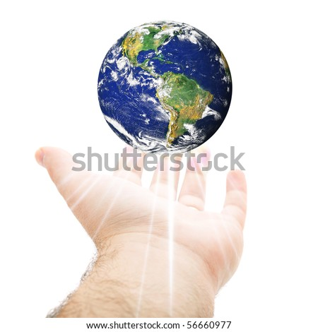 A hand being held out with the earth hovering above.  Earth source image courtesy of NASA. #56660977