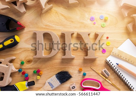 DIY Wood Font Style On a Wooden Workbench Top View.Do it Yourself concept Royalty-Free Stock Photo #566611447