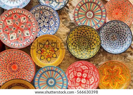 Colorful dish souvenirs for sale in a shop in Morocco Royalty-Free Stock Photo #566630398