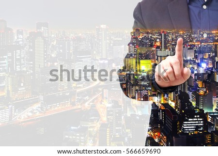 Double exposure businessman use finger touching on screen with city overlay and copy space #566659690