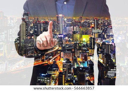 Double exposure businessman use finger touching on screen with city overlay #566663857