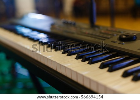 background of piano keyboard, close up electronic piano keys Royalty-Free Stock Photo #566694154