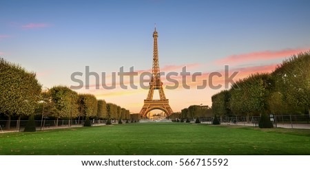 Eiffel Tower on Champs de Mars in Paris, France Royalty-Free Stock Photo #566715592