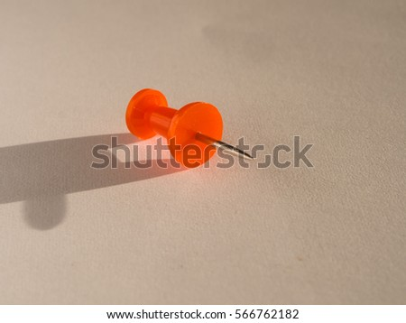 placeholder colored pin stuck on a white sheet of paper #566762182