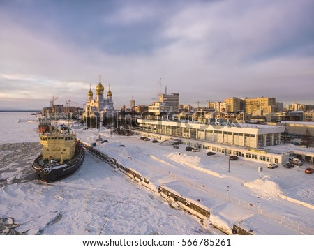 Icebreaker at the pier, the great temple and the building of sea and river station. Russia, Arkhangelsk Oblast, the city of Arkhangelsk #566785261