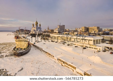 Icebreaker at the pier, the great temple and the building of sea and river station. Russia, Arkhangelsk Oblast, the city of Arkhangelsk #566785273
