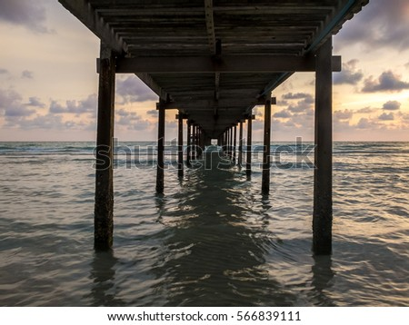 Under the Bridge into the sea at sunset with explore twilight sky, Trat province, Thailand #566839111