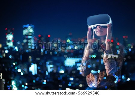 Woman with glasses of virtual reality. Future technology concept. #566929540