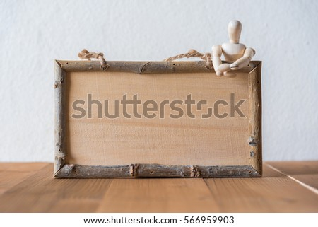 wooden figure dummy with wooden sign board #566959903