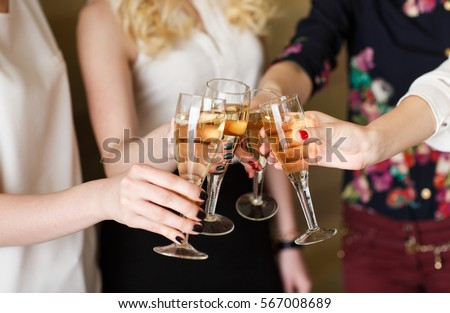 Hands holding the glasses of champagne making a toast #567008689