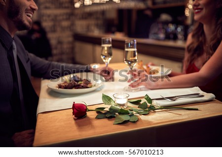 Couple have romantic evening in restaurant  Royalty-Free Stock Photo #567010213