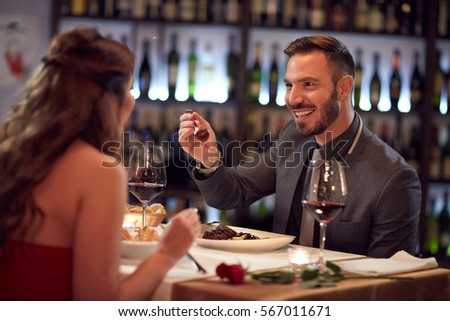 Couple enjoying in good food in restaurant  #567011671