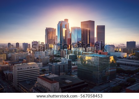 Sunset over Los Angeles downtown. Retro colors. California theme. LA background. Los Angeles city center. Royalty-Free Stock Photo #567058453