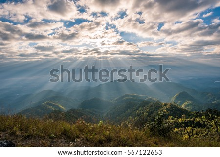 Sunrise over the mountain landscape, A beautiful sun rays with clouds #567122653