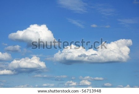 Cumulus Clouds Against a Blue Sky Royalty-Free Stock Photo #56713948