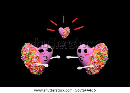 Cartoon face of 2 heart shape of donut covered by pink chocolate rainbow sprinkle decoration on isolate,Valentine day
